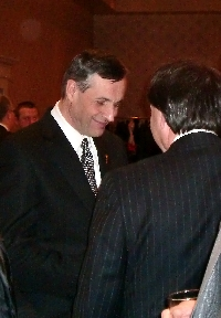 Don speaks with Gordon Wyant at the Saskatoon Southeast Christmas Reception - Click on Image to enlarge